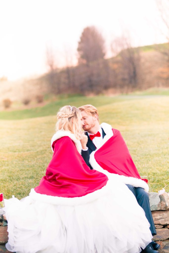 winter wedding couple in red capes