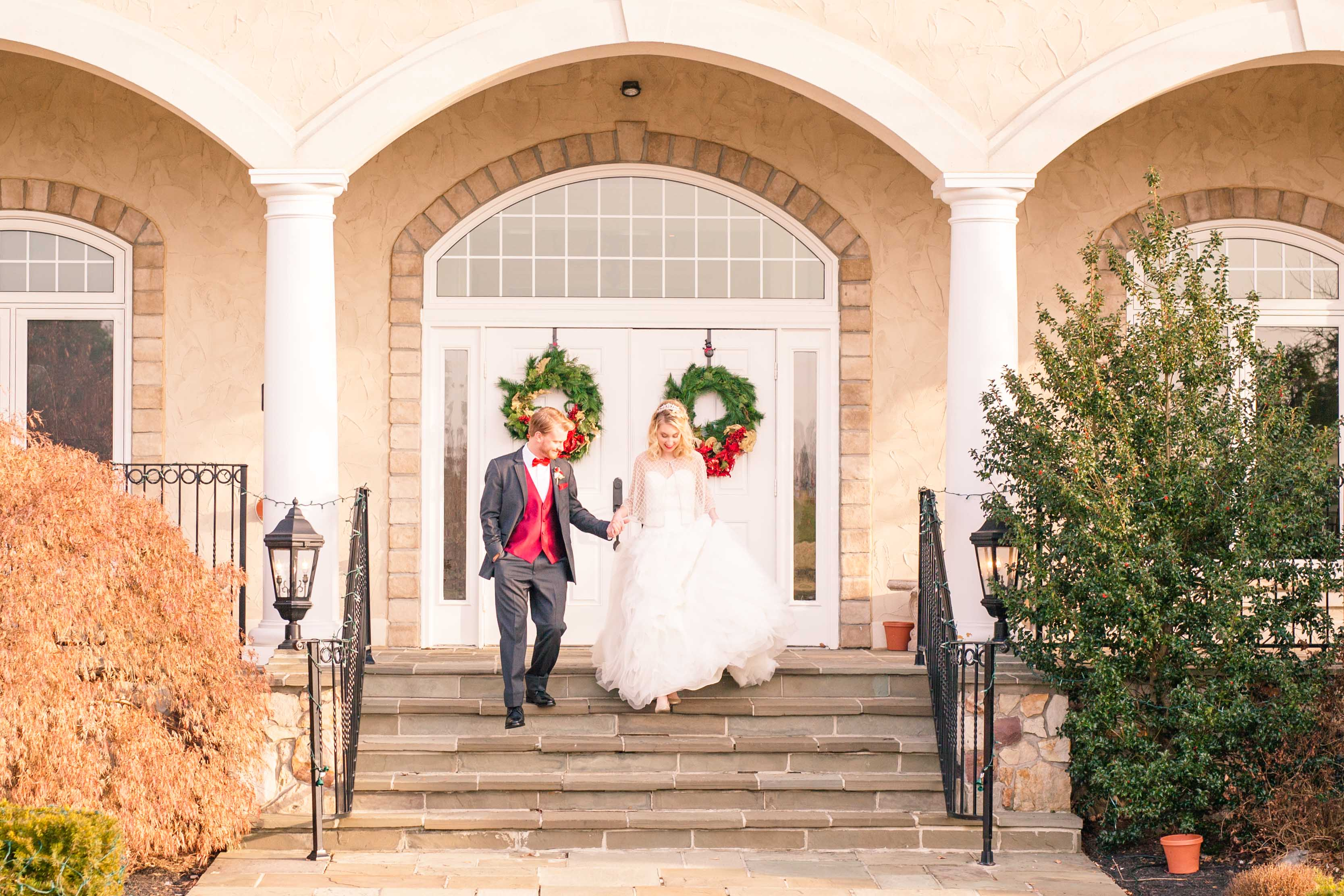 Winter wedding couple descend stairs