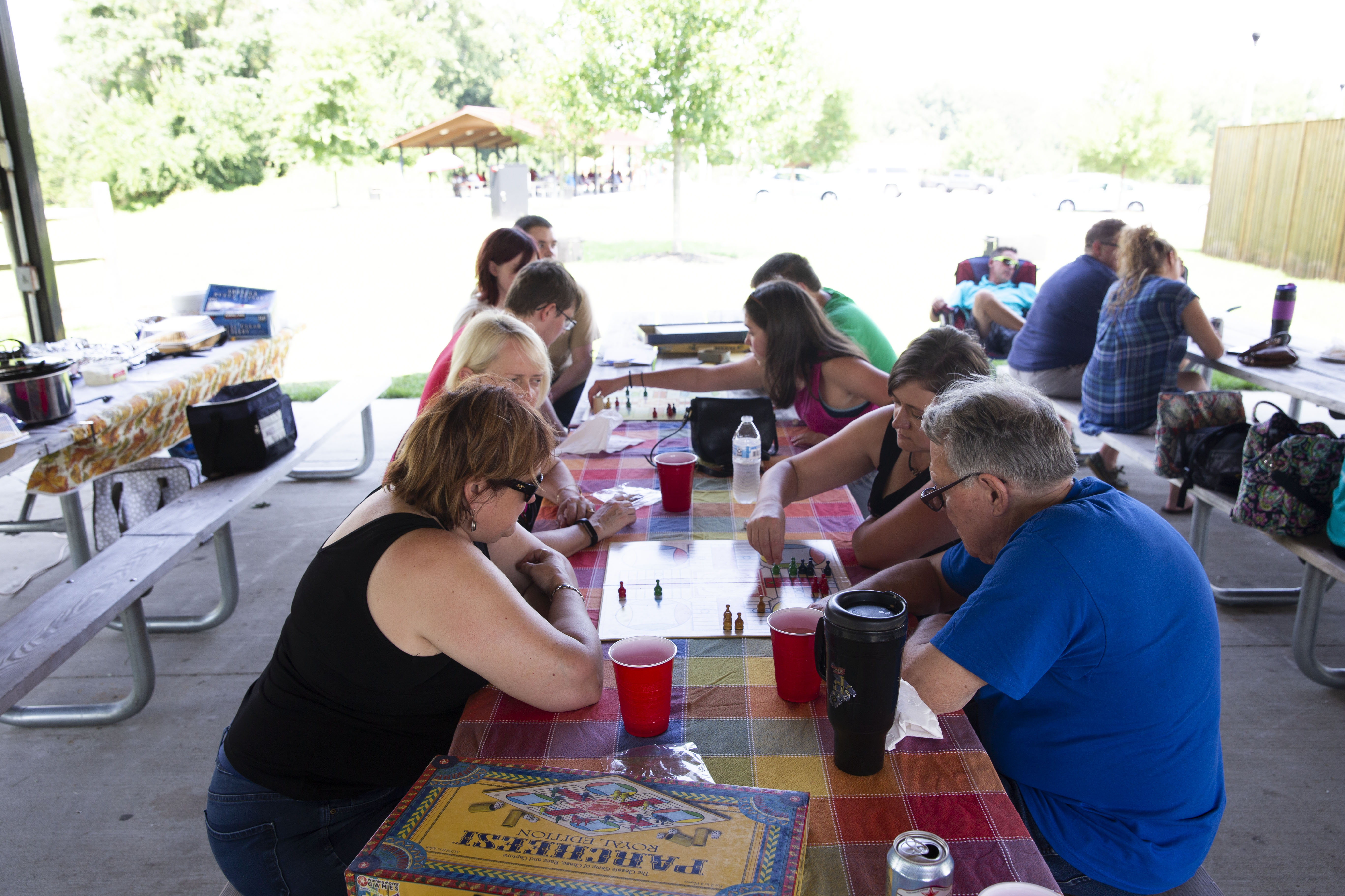 Family members playing table games at a family reunion