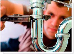 plumber loosening p-trap