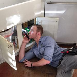 Bellator Pest Control technician doing an inspection