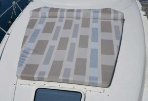 Bow Boat Sunpad in Sunbrella Upholstery Fabric - Avenues Daytime