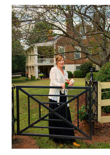 Laura Wood standing at a gate