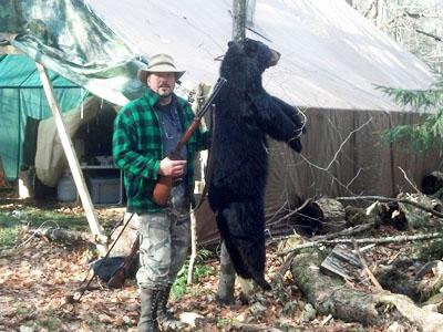 2013: Dan Reed of Oswego, black bear, Colton, NY