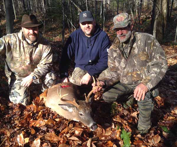 Rick Szurek (right), of the West River Hunting Cub, grunted in this 8-pointer in Hamilton County.