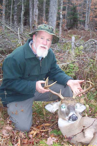 Stan Grose, of Camp Mixed Nuts in Salisbury with a 152-pound, 8-pointer