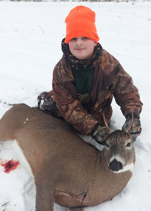 2020: Aden Beckwith, age 14, from Essex County, with his first buck, a 100-pound spike horn take in Franklin County. Congrats Aden!