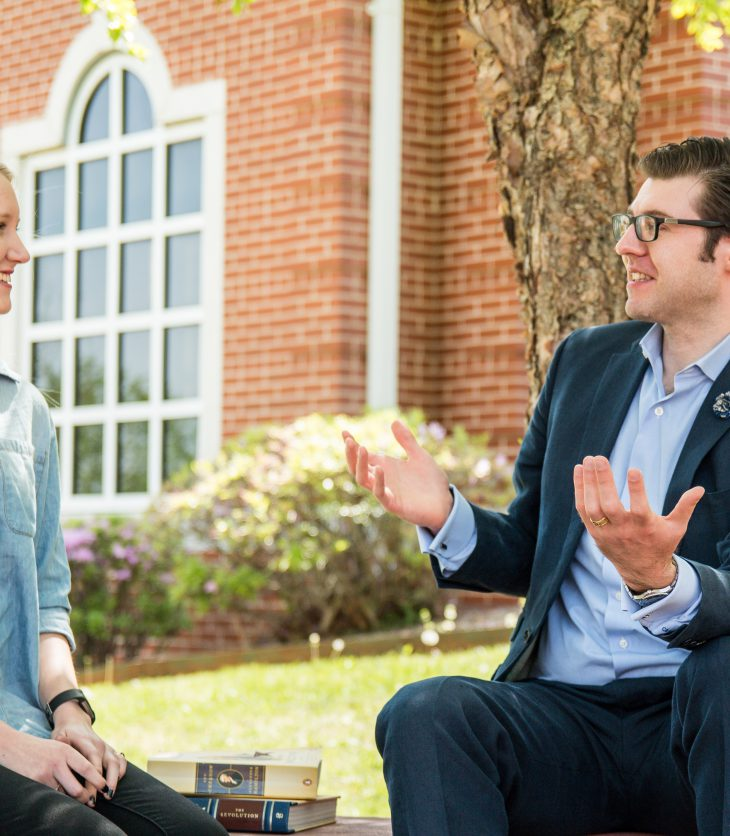 Professor Craig Bruce Smith talks with student Anna Blecha
