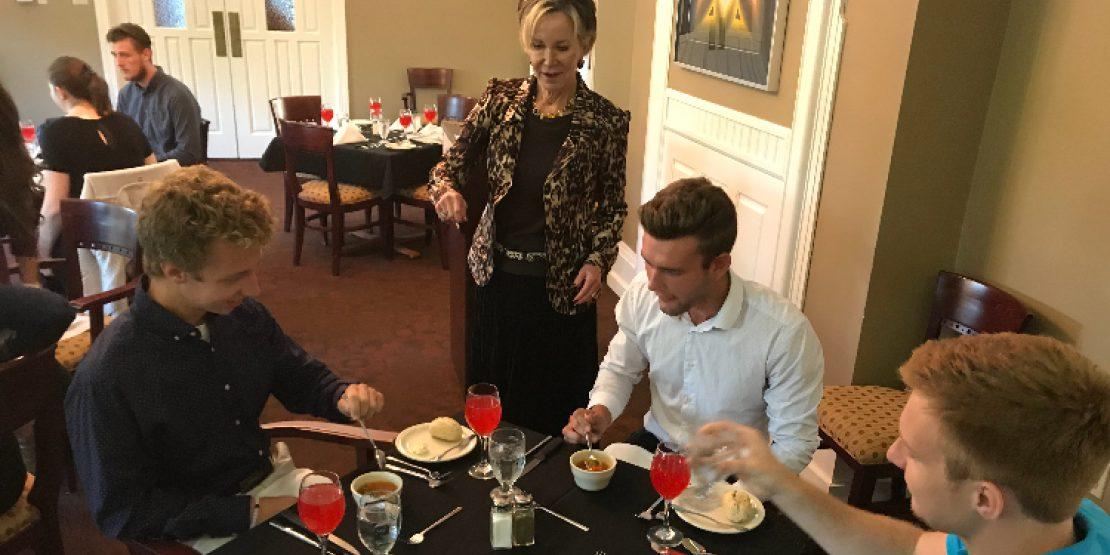 Dr. Jahnae Barnett with Students at Etiquette Dinner