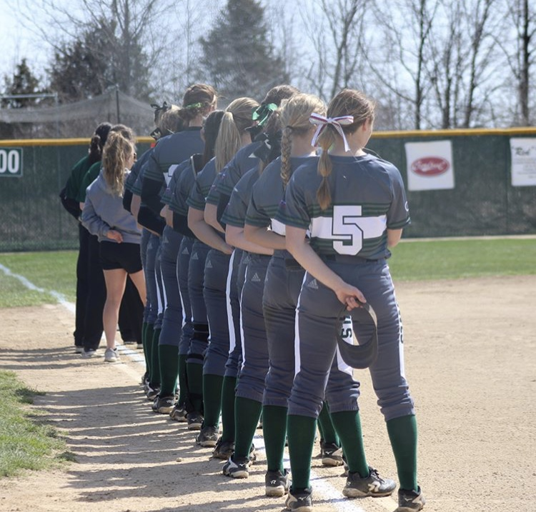 Softball Student-Athletes posing in a line
