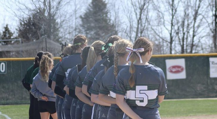 Softball team posed in a line