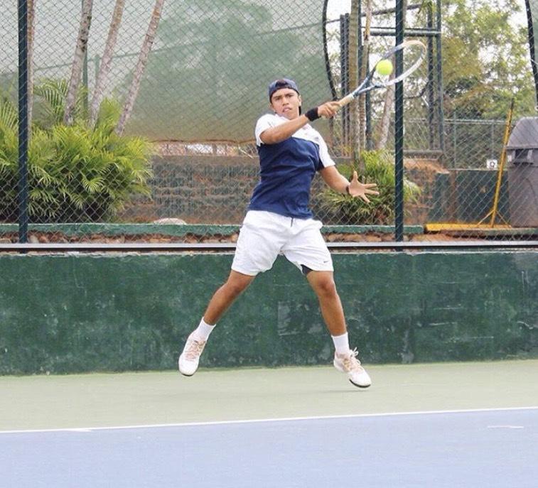 Juan Duran playing tennis