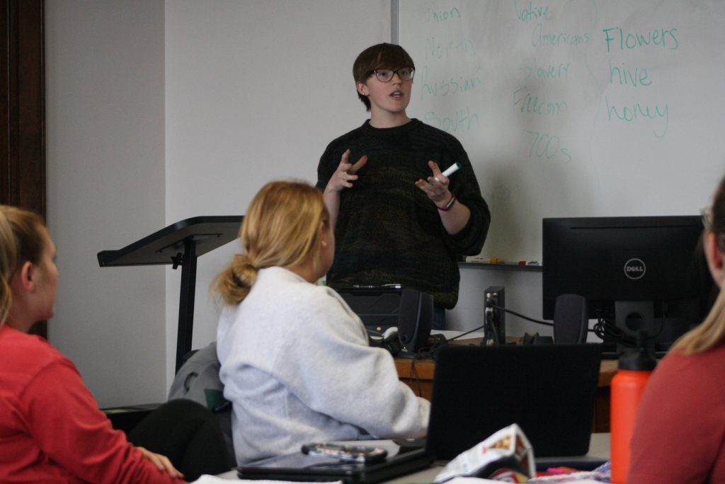 Picture of Adrianna Koty speaking in a classroom