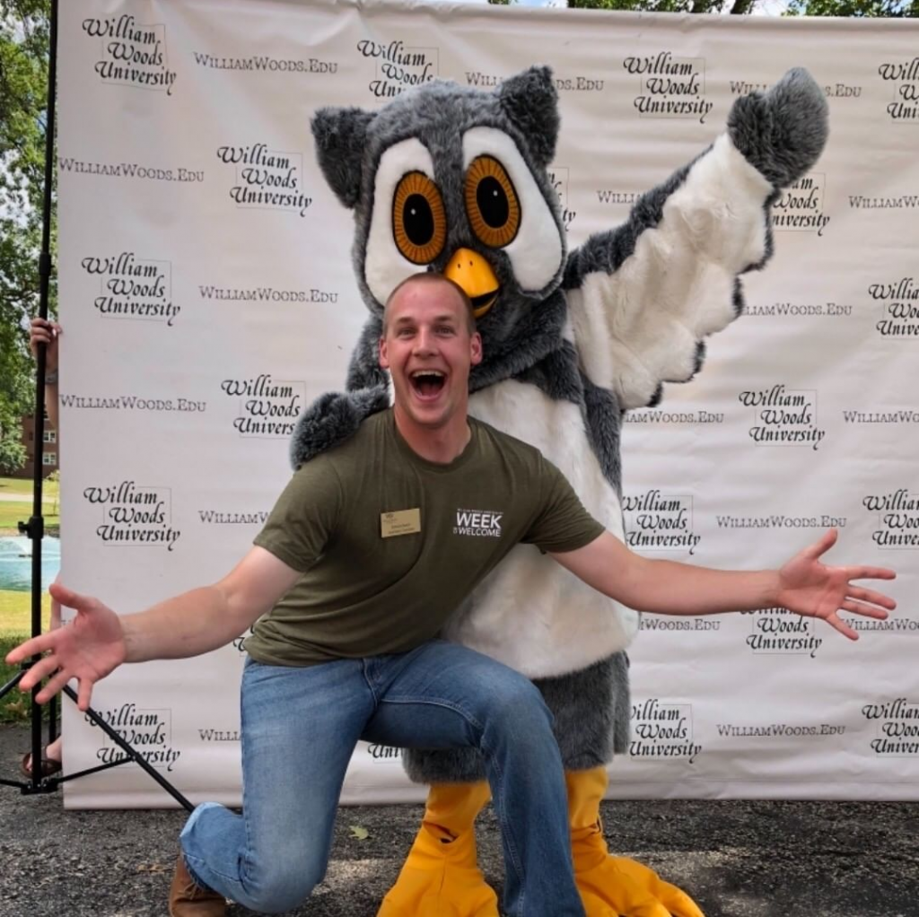 Image of Spencer buck with Screech the mascot