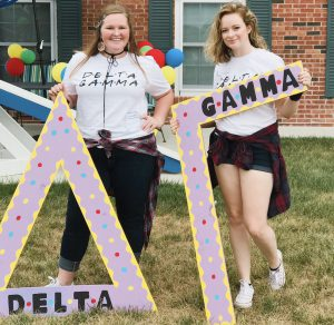 "Shannon holding the ""Gamma"" in ""Delta Gamma"" with a sorority sister"