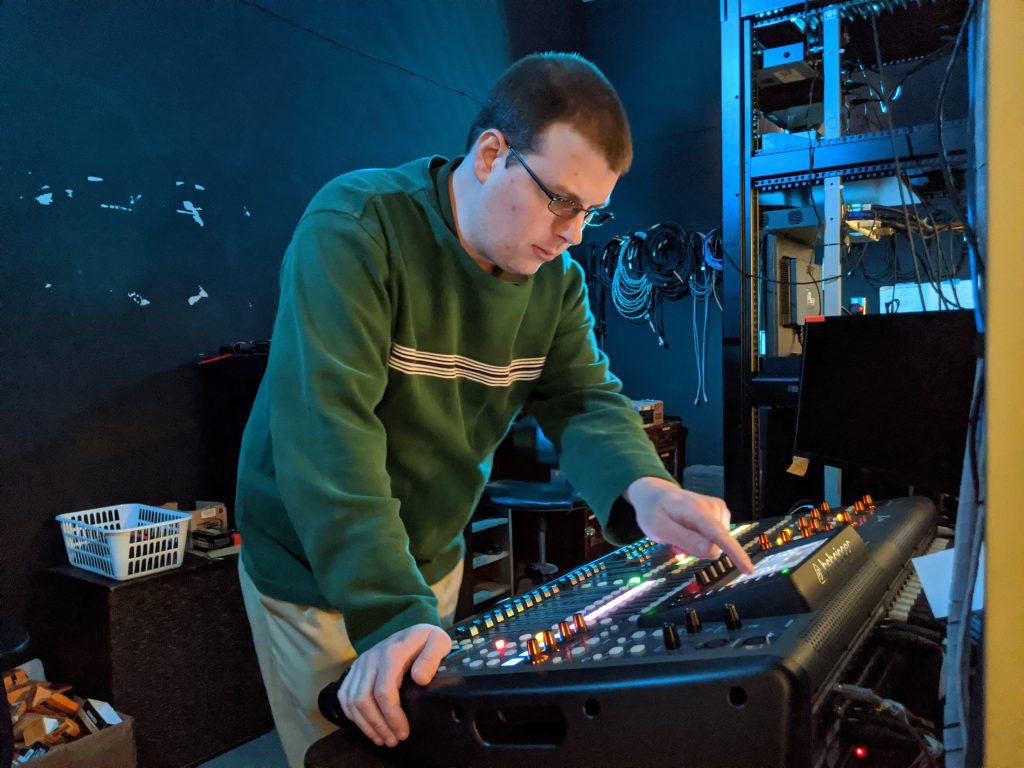 Photo of Shaun Speers working on the sound board