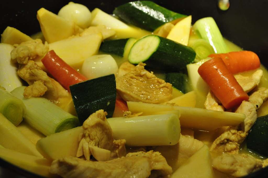 Chicken and vegetables in buttery, spice-filled broth