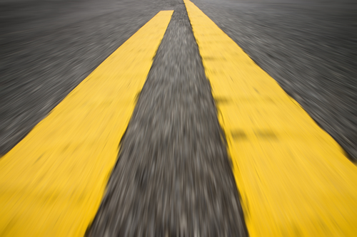 Motion of yellow traffic line on the road.