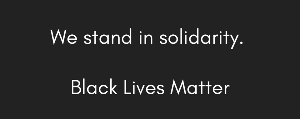 black background with the words we open minds and connect you with a world where all people are valued. We stand in solidarity. Black lives matter.