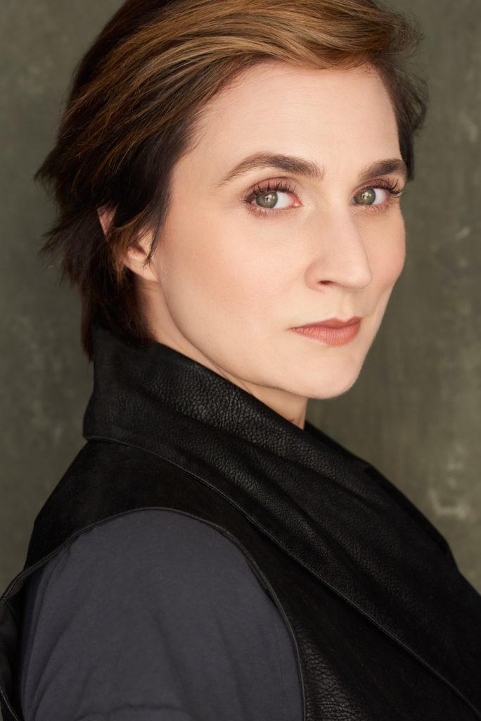 Tanya Gorlow-headshot black vest