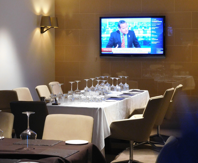 The owner's table in the swanky restaurant and bar, letting him mingle with the moneyed supporters pre-game.