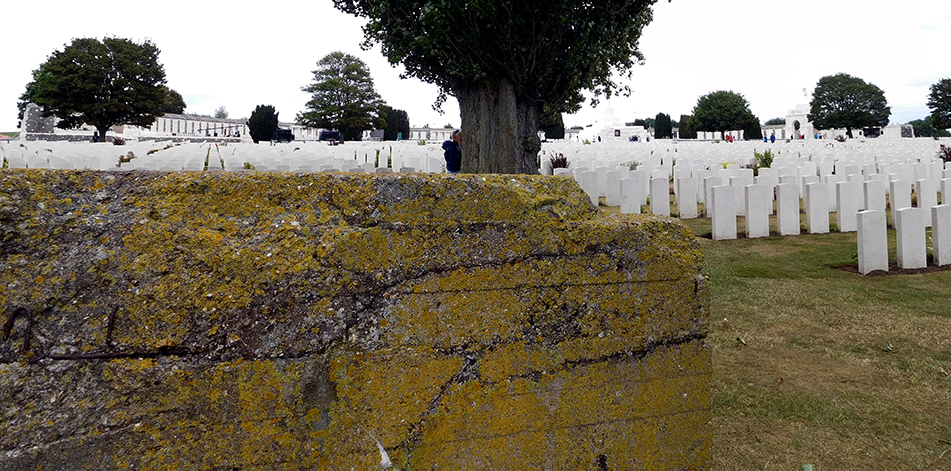 A German pillbox, pockmarked by bullet and artillery fire now stands sentinel in Tyne Cot Cemetery