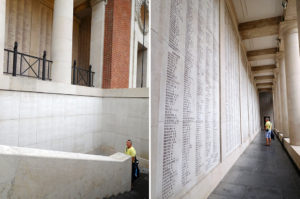 One outside wall and staircase crowded with the names of the missing.