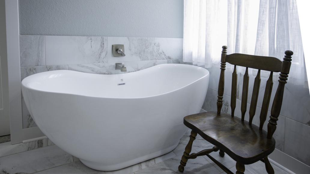 Real Estate Photography interior bathroom, bathing, soaker bathtub, marble, natural light, interior decor, interior design, family, welcome home.