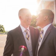 Iraq War veterans marry after 10 years in intimate same-sex ceremony.