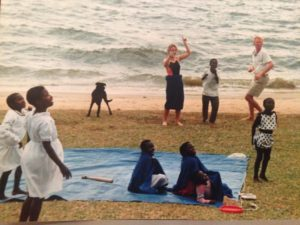 Orphans playing on the beach