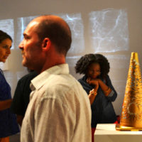 exhibiting artist Dahliya Elsayed gazes at the Precious Metal in Newark Museum