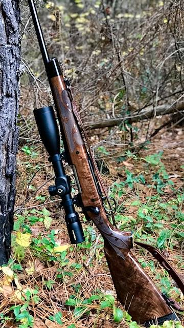 Quigley Ford Scope Long Range Scope leaning on a tree