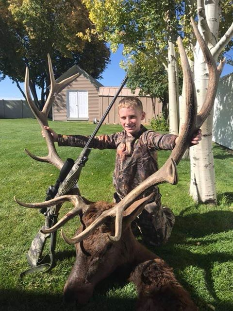 Boy elk hunting with Quigley Ford long range scope