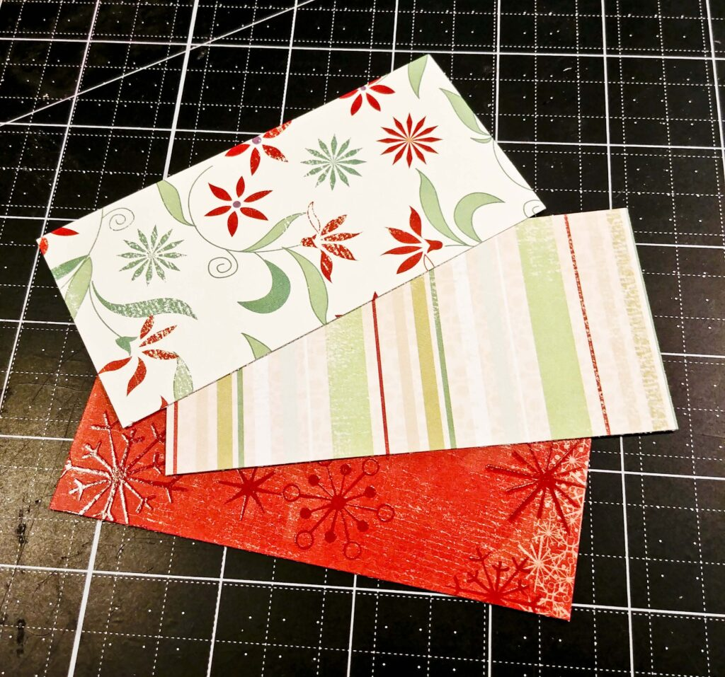 Three pieces of patterned paper