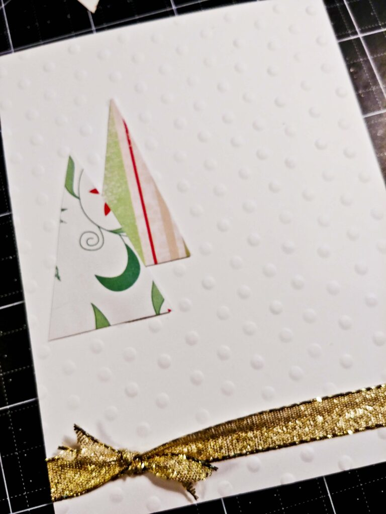 Glue trees onto embossed paper