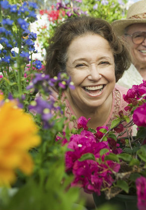 Woman peeking through flowers