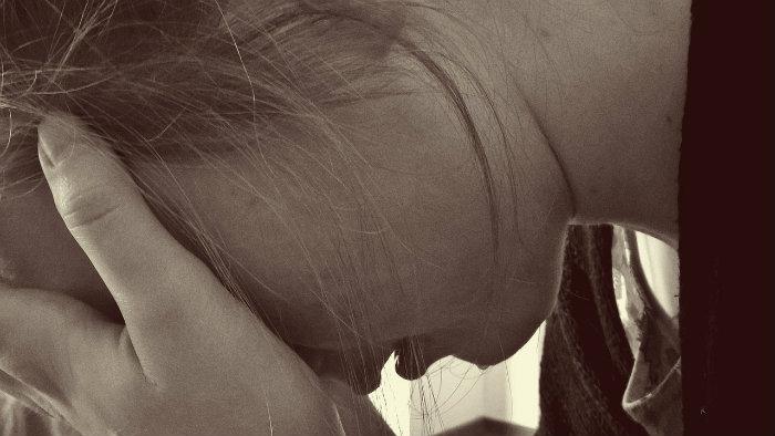sad teen contemplating suicide