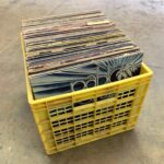 Yard sale albums in crate