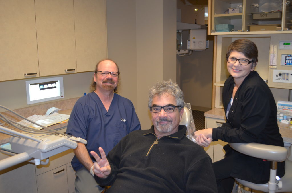 Dr. Hickey sits with a patient and Kirsten before starting an exam as part of the general dentistry menu options in his Tacoma WA office.