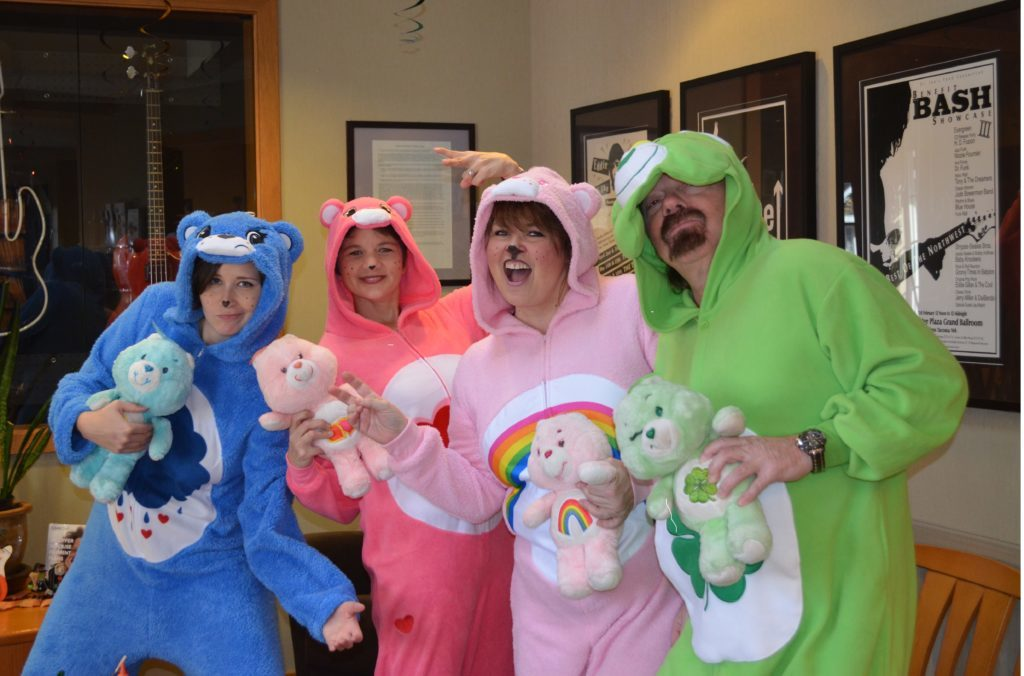 The team at Sound to Mountain dress up for a children's open house to promote their pediatric dentistry services and give the kids a fun experience at the dentist..