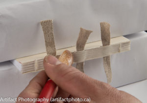 Pasting the second strip of Japanese paper to the mull