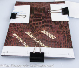 Book with spring clamps and template