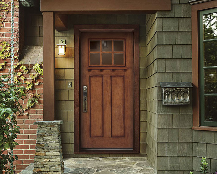 Wooden farmhouse-style front entry door