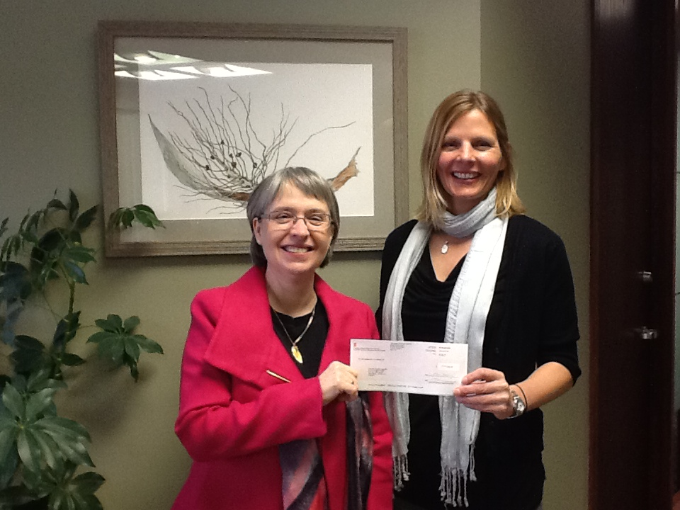 Carol Bennett Bray presents a cheque to the Agapé Centre