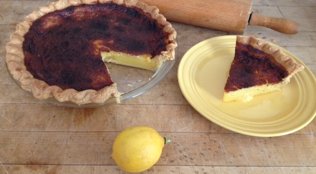 lemon pie slice on counter with rolling pin