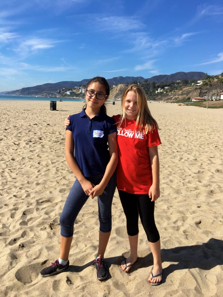 Paola and her friend from Calvary Christian school at the beach cleanup.