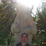 Brian K. man standing in front of a bear statue