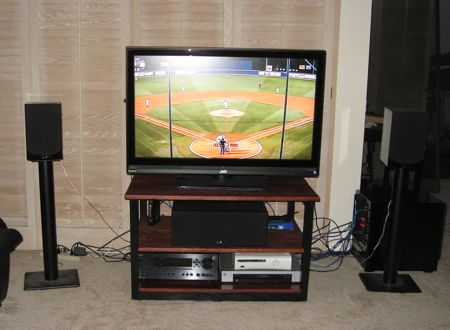 TV Stand in Living Room with TV On and Components Installed