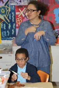 Sarah Bond with a student