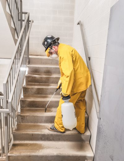 Employee Disinfects the Entire Building